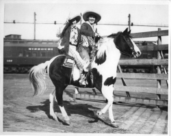 Legendary cowgirls, Ruth Roach and Tad Lucas, riding double in the Fort Worth Stockyards.